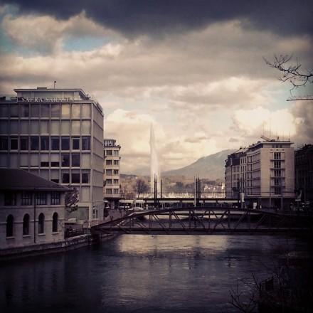 Geneva between clouds and sun